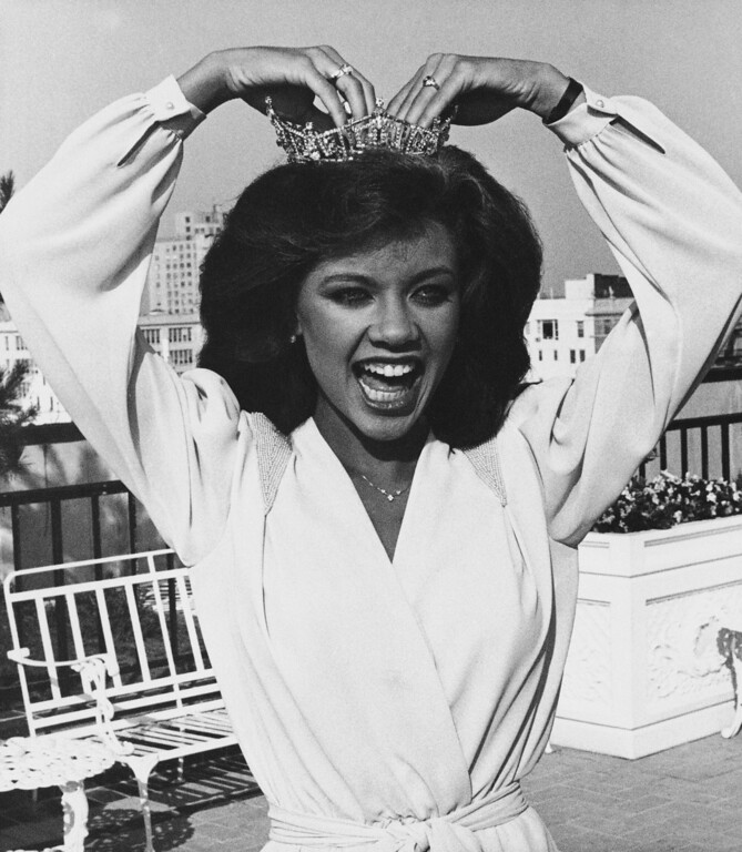 Description of . Vanessa Williams, Miss America for 1984 adjusts her crown during photo session, Sunday, Sept. 19, 1983 in Atlantic City, New Jersey. (AP Photo)