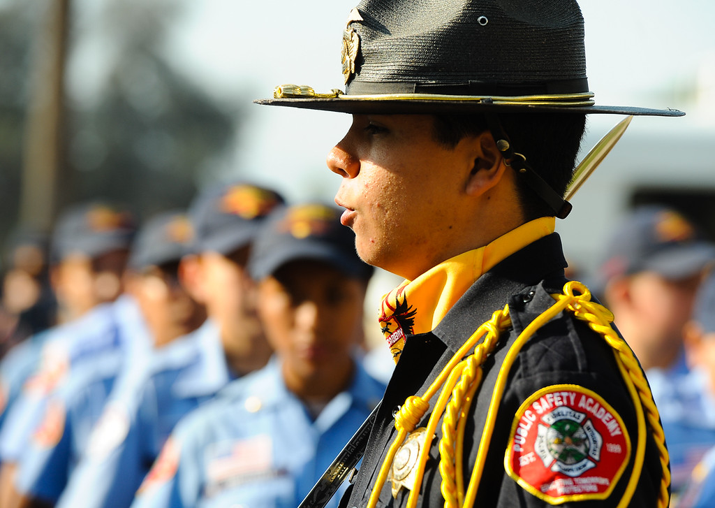 Description of . Honor Guard Commander Victor Hernandez, 16, leads his peer during a 9/11 remembrance ceremony at the Public Safety Academy in San Bernardino on Wednesday, Sept. 11, 2013. (Photo by Rachel Luna / San Bernardino Sun)