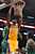 Lakers Earl Clark slams in two points as Celtics' Jeff Green defends  during second half action at Staples Wednesday. Lakers defeated the Celtics 113-99.  Photo by David Crane/Staff Photographer