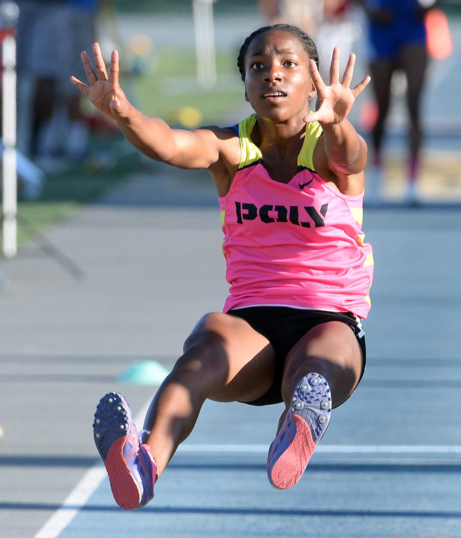 Description of . Pasadena Poly's Onyx Gaston competes in the Triple Jump during the CIF-SS Masters Track and Field meet at Falcon Field on the campus of Cerritos College in Norwalk, Calif., on Friday, May 30, 2014.   (Keith Birmingham/Pasadena Star-News)