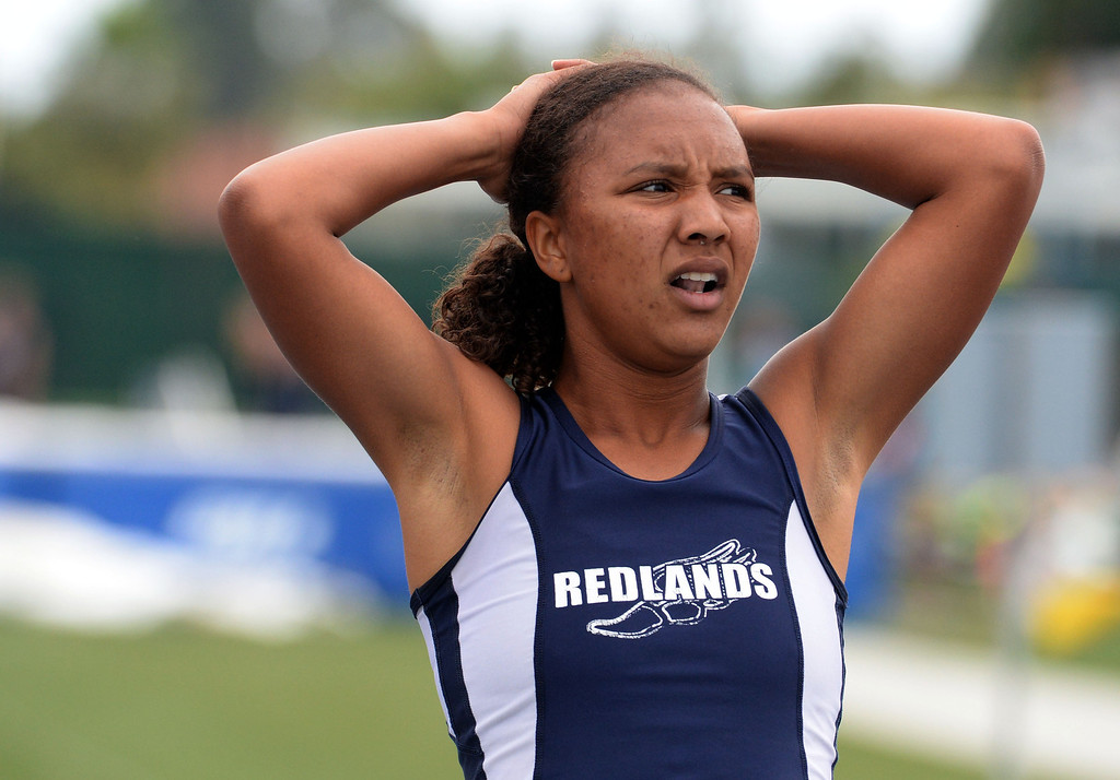 Description of . Redland's Margaux Jones finishes second in the division 2 200 meters race during the CIF Southern Section track and final Championships at Cerritos College in Norwalk, Calif., Saturday, May 24, 2014. 
