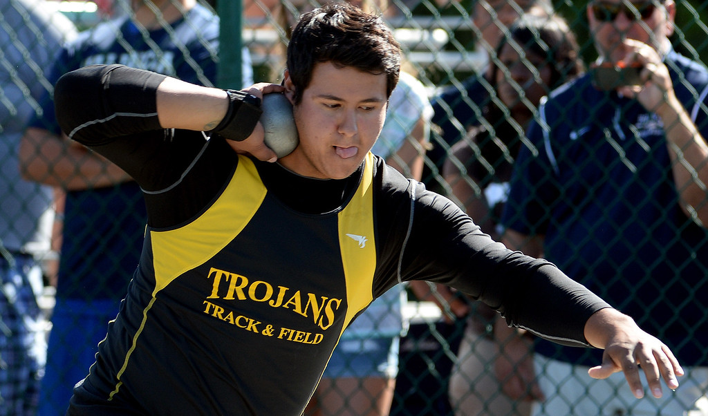 Description of . Yucca Valley's Trevor Gorwin competes in the shot put during the CIF-SS Masters Track and Field meet at Falcon Field on the campus of Cerritos College in Norwalk, Calif., on Friday, May 30, 2014.   (Keith Birmingham/Pasadena Star-News)