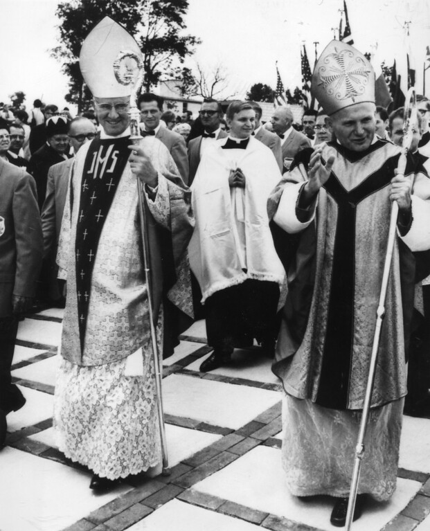 Description of . Cardinal Karol Wojtyla, right, the newly elected Pope John Paul II, waves to the crowd in Doylestown, PA., Sept. 28, 1969, as he walks in procession with Cardinal John Krol, archbishop of Philadelphia. Cardinal Wojtyla, former archbishop of Krakow, Poland, was the first Polish prelate to visit the United States. (Ap Photo)