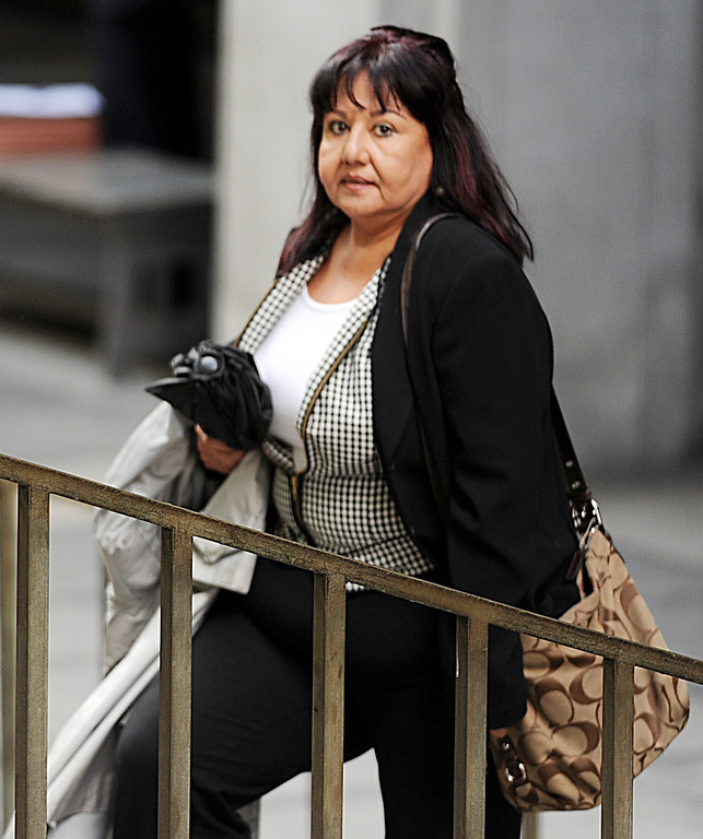 Description of . Former Irwindale Councilwoman Rosemary Ramirez, leaving Clara Shortridge Foltz Criminal Justice Center.  Councilman, Manuel Garcia,  Mayor Mark Breceda, Finance Director Abe DeDios,  and former Irwindale Councilwoman Rosemary Ramirez, were with their attorneys at Clara Shortridge Foltz Criminal Justice Center Thursday, February 27, 2014.  Irwindale officials are accused of misappropriation of public funds, conflict of interest and embezzlement spending $200,000 on trips to New York City between 2001-2005.  Their arraignment was postponed once again to April 9, 2014.(Photo by Walt Mancini/San Gabriel Valley Tribune)