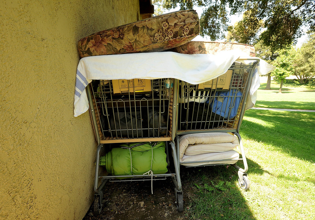 Description of . A view of a homeless camp, that includes bedding and a suitcase, is visible at Jennie Davis Park in Redlands August 16, 2013.  Homelessness has become a large problem in the San Bernardino County area. GABREL LUIS ACOSTA/STAFF PHOTOGRAPHER.