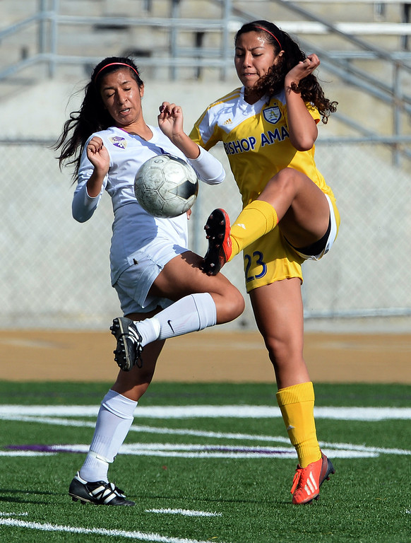 Description of . Bishop Amat's Aleena Garcia (23) fights for the ball with Diamond Bar's Lesley Horcasitas in the first half of a CIF-SS second round prep playoff soccer match at Diamond Bar High School in Diamond Bar, Calif., on Wednesday, Feb.26, 2014. Diamond Bar won 3-2.