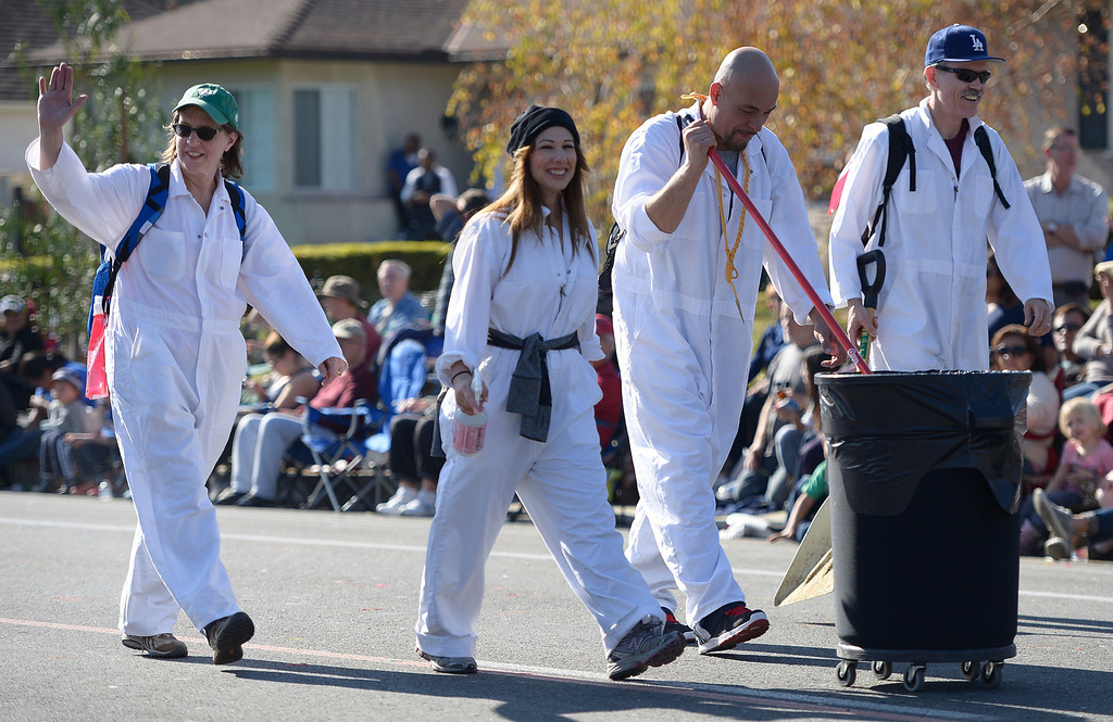 Description of . To many participants marching in the parade, these guys are their favorite. The scoopers are seen near the end of the parade route during the 2014 Rose Parade in Pasadena, CA January 1, 2014.(John McCoy/Los Angeles Daily News)