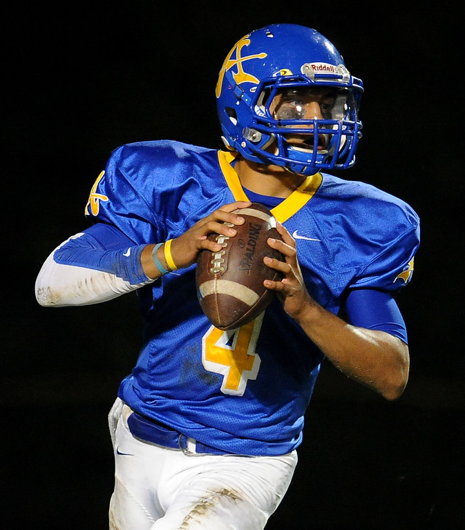 Description of . Bishop Amat quarterback Koa Haynes (C) passes against Alemany in the first half of a prep football game at Bishop Amat High School in La Puente, Calif., on Friday, Oct. 25, 2013.    (Keith Birmingham Pasadena Star-News)