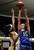 Agoura #15 Kim Jacobs shoots over Gahr #10 Ra'Vyn Bowser. Agoura defeated Gahr 60-39 in the CIF-SS Division III-AAA Girls Basketball Championship at the Anaheim Convention Center in Anaheim, CA 2/23/2013(John McCoy/Staff Photographer)