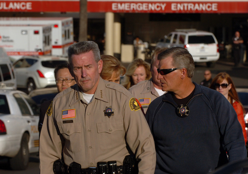 Description of . San Bernardino County Sheriff John McMahon, left, walks away from the  Loma Linda University Medical Center emergency room to report to the media that one of his deputies, Jeremiah McKay, was killed and another injured during a shootout with Christopher Dorner in the Big Bear area February 12, 2013. (Staff photo by Thomas R. Cordova/Inland Valley Daily Bulletin)