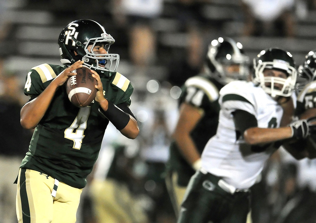 Description of . South Hills quarterback Garrett Fonseca (4) prepares to pass against Bonita in the first half of a prep football game at Covina District Field in Covina, Calif. on Friday, Sept. 6, 2013.   (Photo by Keith Birmingham/Pasadena Star-News)