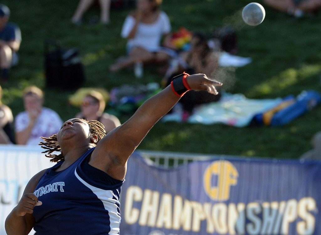 Description of . Summit's Destiny Parker competes in the shot put during the CIF California State Track & Field Championships at Veteran's Memorial Stadium on the campus of Buchanan High School in Clovis, Calif., on Saturday, June 7, 2014. 