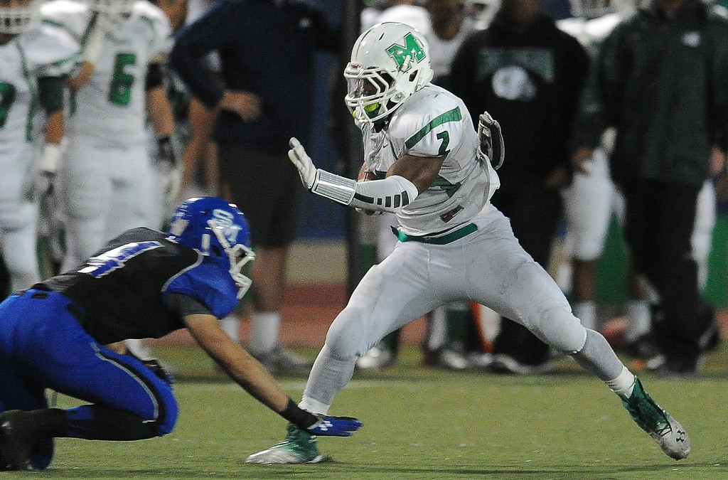Description of . Monrovia's Kurt Scoby (2) runs past San Marino's Mark Wicke (4) for a first down in the first half of a prep football game at Monrovia High School in Monrovia, Calif., on Friday, Nov. 8, 2013. 
