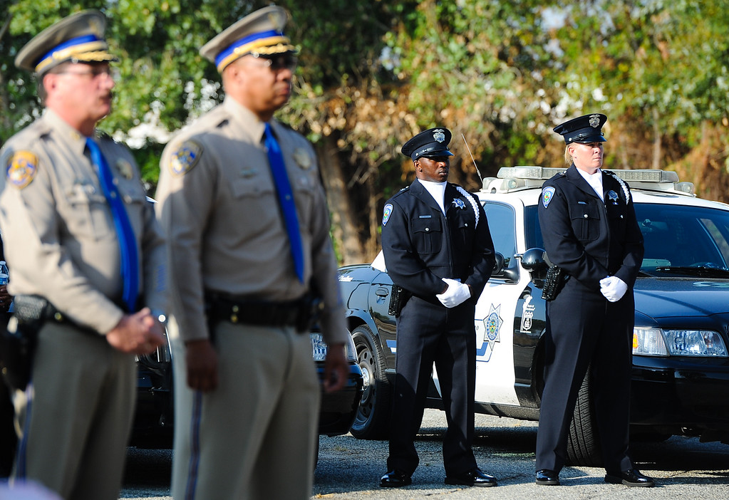Description of . San Bernardino police and CHP officers listen to a 9/11 remembrance ceremony at the Public Safety Academy in San Bernardino on Wednesday, Sept. 11, 2013. (Photo by Rachel Luna / San Bernardino Sun)