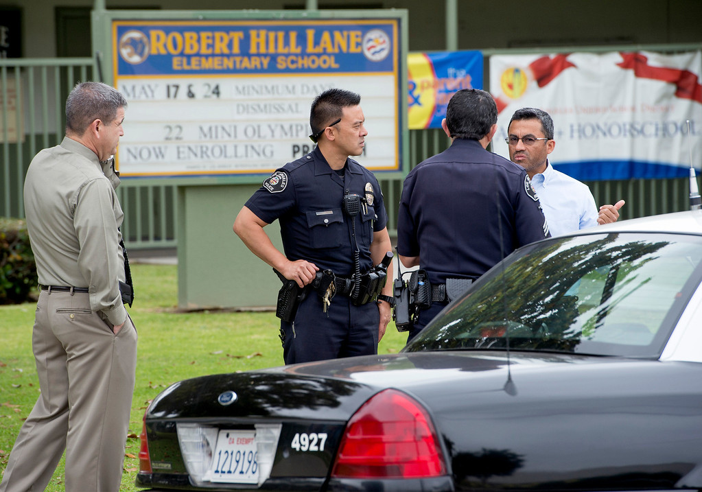 Description of . Los Angeles School Police lockdown Robert Hill Lane Elementary School on Cesar Chavez Avenue across from East Los Angeles Community College after a man threatened to shoot up that campus as well as Santa Monica Community College May 16, 2013.   (SGVN/Staff photo by Leo Jarzomb)