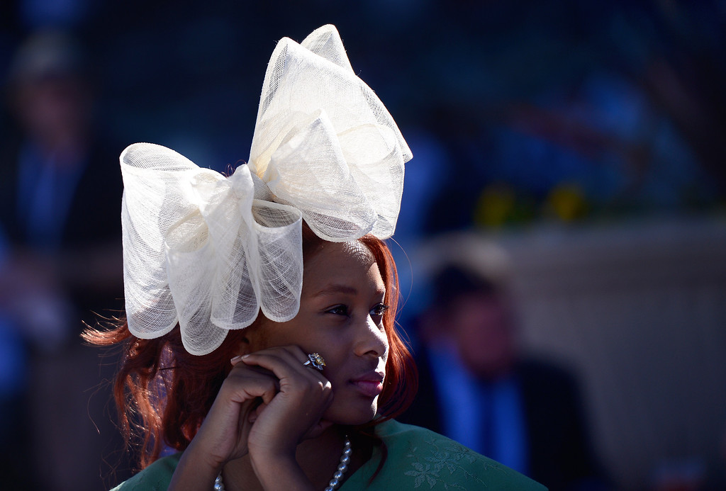 Description of . Quela Renee, of Los Angeles, wears a hat she had shipped from the UK during the Breeders' Cup at Santa Anita Park in Arcadia Friday, November 1, 2013. (Photo by Sarah Reingewirtz/Pasadena Star-News)