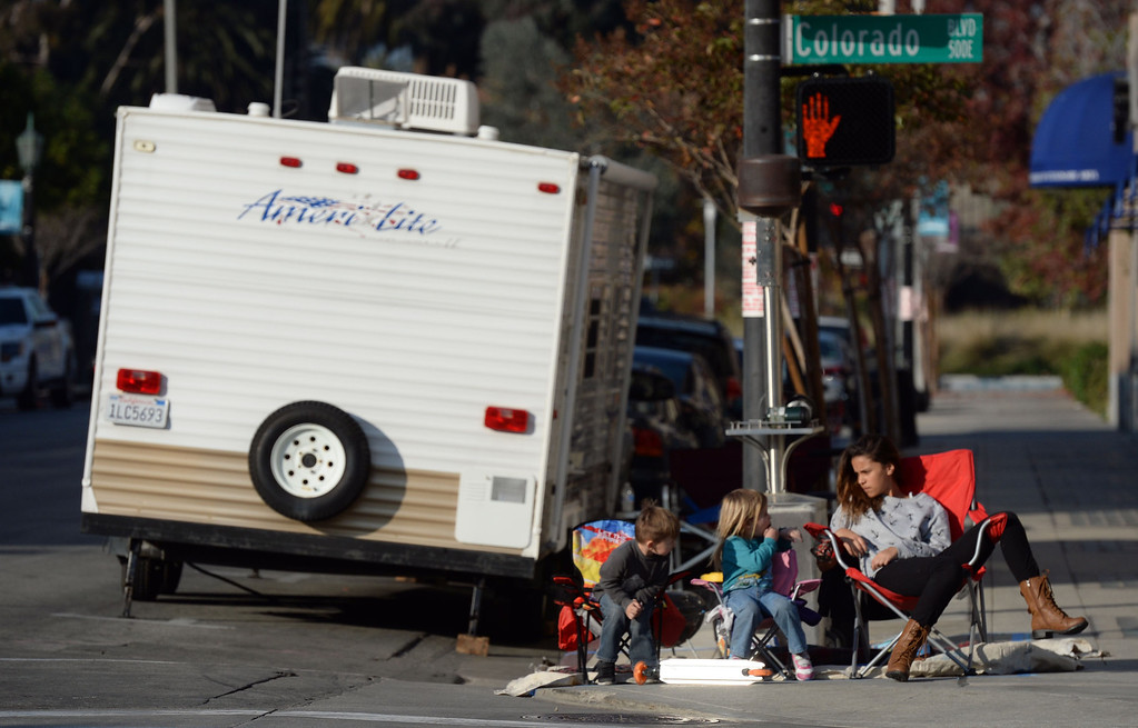 Description of . People camp out and stake their spots for the Rose Parade along Colorado Boulevard in Pasadena, Calif., on Tuesday, Dec. 29, 2013.     (Keith Birmingham Pasadena Star-News)