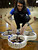 Russel Smith checking his quadcopter before competition at this year's 28th Annual ME72 Engineering Design Contest,