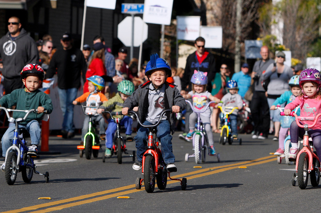 Description of . Collin Randolph, 3, center, of Yucaipa, participates in the public race portion of the Redlands Bicycle Classic on Saturday, April 5, 2014 in Redlands, Ca.  (Photo by Micah Escamilla for the Redlands Daily Facts)