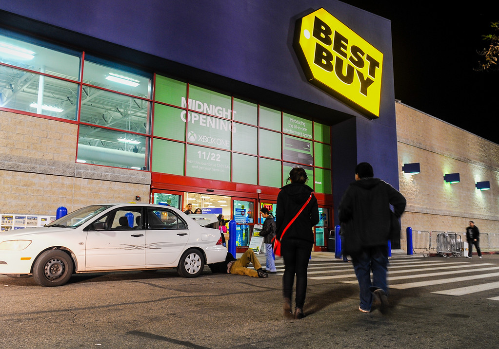 Description of . Shoppers search for deals at Best Buy after the store opened its doors at 6 p.m. for early Black Friday sales on Thanksgiving in San Bernardino on Thursday, Nov. 28, 2013. Many retail stores pushed the boundary the Black Friday tradition this year with offering Black Friday deals on Thanksgiving day. (Photo by Rachel Luna / San Bernardino Sun)
