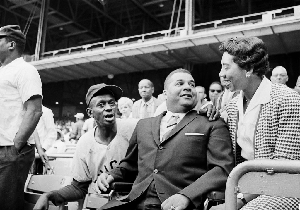 Description of . Roy Campanella, center, former major league catcher, chats with Althea Gibson, former tennis star and Satchel Paige at the Negro American League\'s 29th East-West All-Satr game at New York\'s Yankee Stadium, Aug. 20, 1961. Paige, former pitcher for the Cleveland Indians and St. Louis Browns, started the game for the west. (AP Photo)