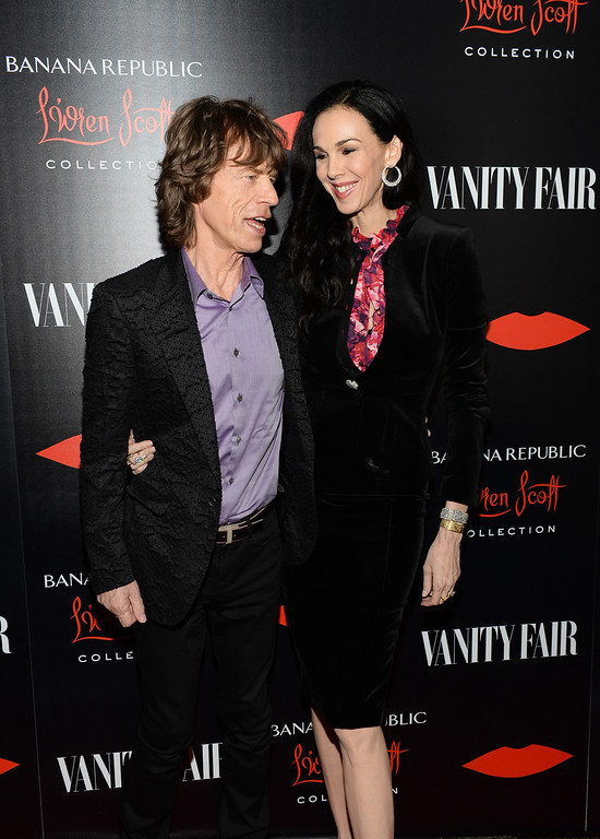 Description of . Singer Mick Jagger and fashion designer L'Wren Scott attend the launch celebration of the Banana Republic L'Wren Scott Collection hosted by Banana Republic, L'Wren Scott and Krista Smith at Chateau Marmont on November 19, 2013 in Los Angeles, California.  (Photo by Michael Kovac/Getty Images for Banana Republic)