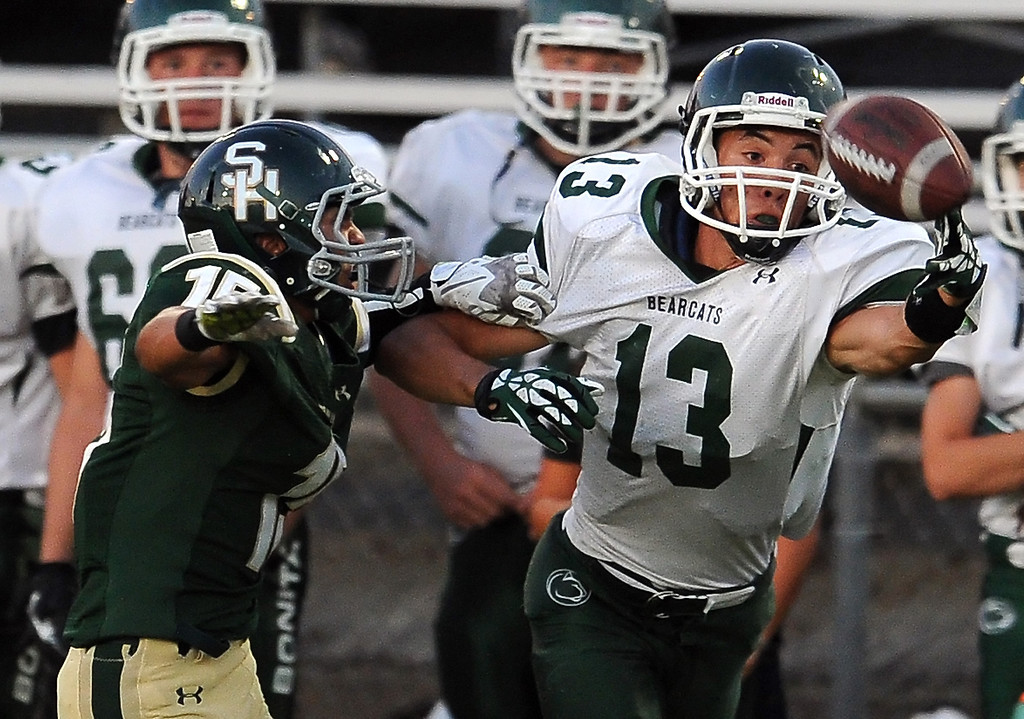 Description of . Bonita's Dimas Diaz (13) catches a pass for a first down past South Hills' Carlos Delgado (15) in the first half of a prep football game at Covina District Field in Covina, Calif. on Friday, Sept. 6, 2013.   (Photo by Keith Birmingham/Pasadena Star-News)