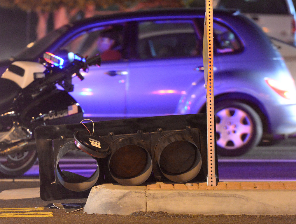 Description of . A traffic signal fell on traffic lanes at the intersection of Beach Boulevard and Lambert Road after the 5.1 earthquake in La Habra on Friday March 28, 2014. (Staff Photo by Keith Durflinger/Whittier Daily News)