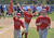 LONG BEACH, CALIF. USA -- 	Angels player Joshua Hindman, 6, left, carries a big foam finger as he joins his teammates running on the field as their team is announced during opening ceremonies for The Los Altos Youth Baseball and Softball league at El Dorado Park in Long Beach, Calif. on March 2, 2013.  Photo by Jeff Gritchen / Los Angeles Newspaper Group