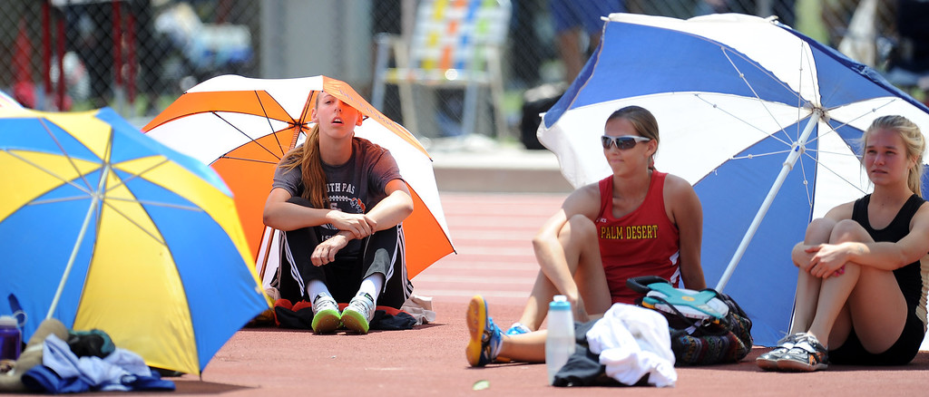 Description of . South Pasadena's Claire Kieffer-Wright takes a break prior to winning the high jump at 5'11