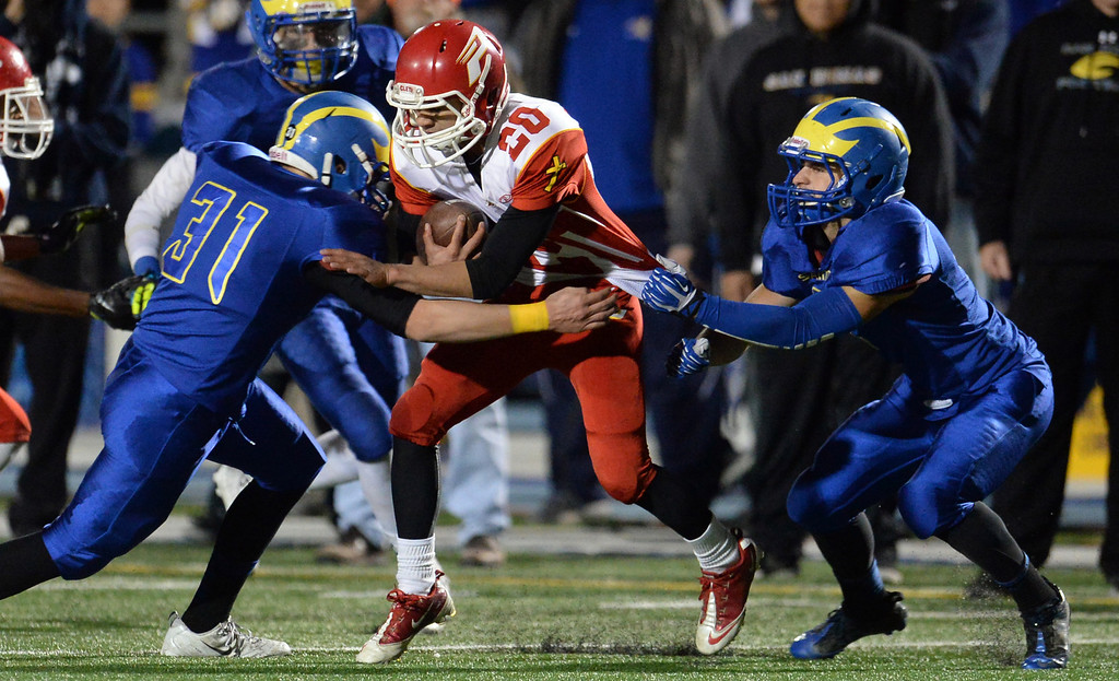 Description of . San Dimas defense tackles Paraclete's Darma Poonosamy (20) for a loss of yards in the second half of a CIF-SS Mid-Valley Division championship football game at San Dimas High School in San Dimas, Calif., on Friday, Dec. 6, 2013. San Dimas won 20-14.  (Keith Birmingham Pasadena Star-News)