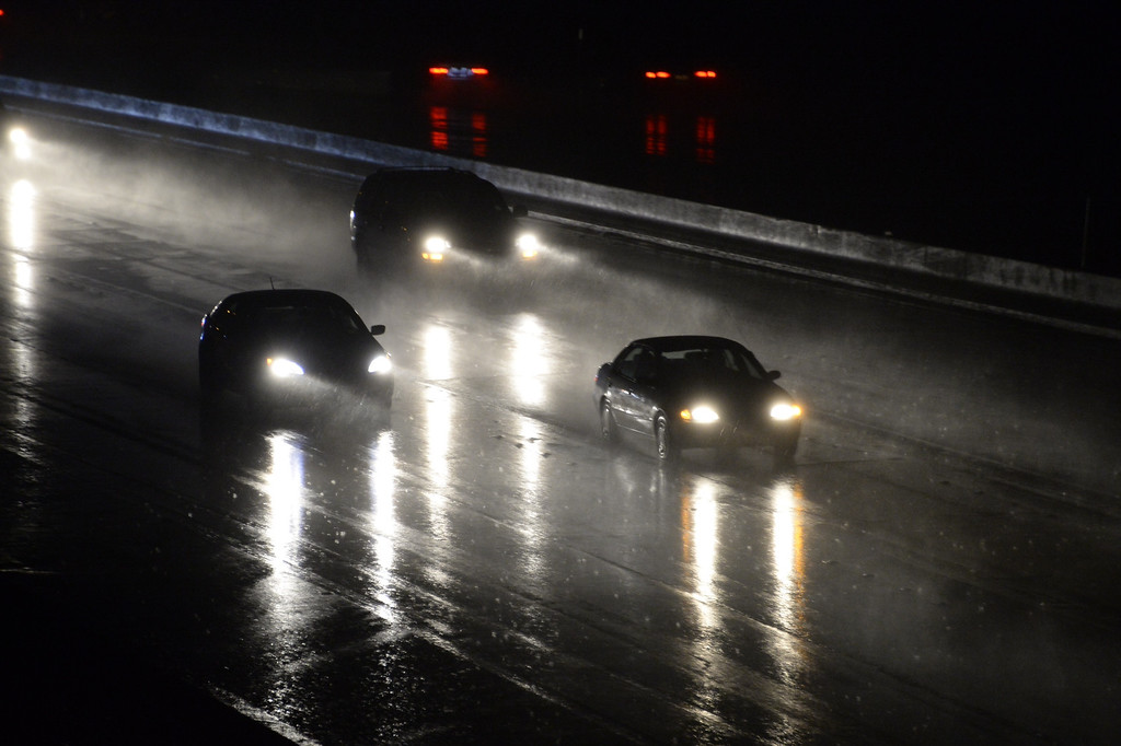 Description of . People make their way home on the 118 freeway in Chatsworth late Wednesday, Feb. 26, 2014, as the first of two storms makes its way into the Southland. (Photo by Gene Blevins/L.A. Daily News)