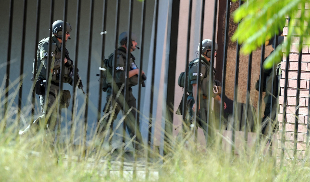 Description of . Arcadia SWAT team walk through the campus after a lockdown at Arcadia High School in Arcadia, Calif. on Thursday, Sept. 12, 2013.   (Photo by Keith Birmingham/Pasadena Star-News)