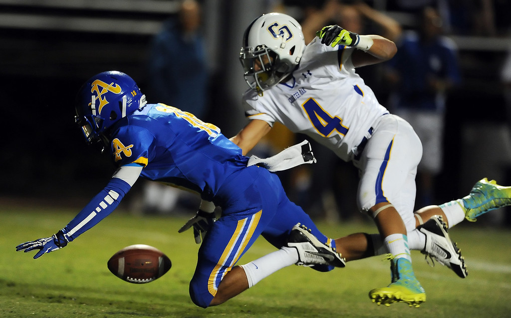 Description of . Bishop Amat's Trevon Sidney (18) knocks away a pass intended for Charter Oak's Donavin Washington (4) in the first half of a prep football game at Bishop Amat High School in La Puente, Calif. on Friday, Sept. 20, 2013.    (Photo by Keith Birmingham/Pasadena Star-News)