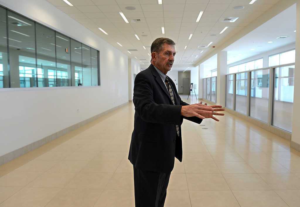 Description of . AJ Wilson, executive director for the San Bernardino International Airport, talks about Thursday's grand opening of the regional airport's International arrivals building while giving a tour new the facility. The three-story, 40,000 square foot building features a customs and immigration passenger arrival area, administrative offices, screening booths, baggage claim area, public restrooms, and an aircraft arrival area large enough to accommodate aircraft such as a 747. (Staff photo by Rick Sforza/The Sun)