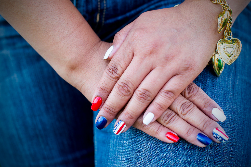 Description of . Hashmat Guerra, of Eagle Rock, wears patriotic nail polish as she waits for Americafest's annual fireworks show at the Rose Bowl in Pasadena Friday night, July 4, 2014. (Photo by Sarah Reingewirtz/Pasadena Star-News)