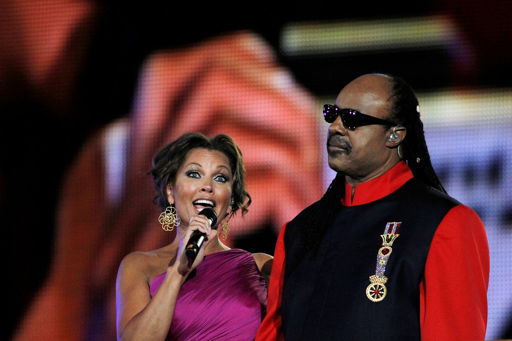 Description of . U.S. singer and actress Vanessa Williams and U.S. singer and songwriter Stevie Wonder perform at the marble Panathinaikon stadium in Athens during the opening ceremony of the Special Olympics Athens 2011 World Games on  Saturday, June 25, 2011. More than 7,500 athletes with mental disabilities  from 185 countries will take part in the Special Olympics which begin Saturday and will end on July 4. (AP Photo/Kostas Tsironis)
