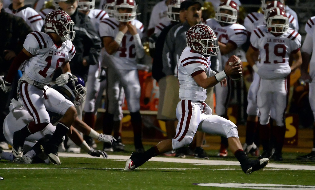 Description of . La Serna quarterback Frankie Palmer (9) scrambles for a first down against Diamond Bar in the first half of a CIF-SS playoff football game at Diamond Bar High School in Diamond Bar, Calif., on Friday, Nov. 22, 2013.   (Keith Birmingham Pasadena Star-News)