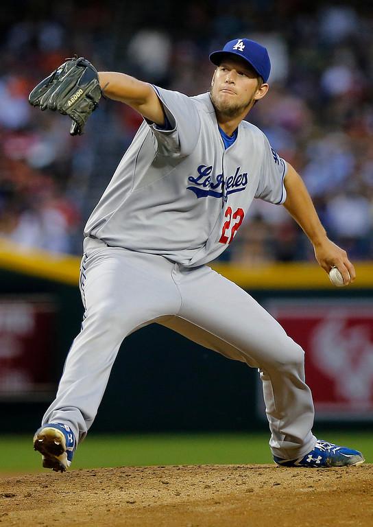 Description of . Los Angeles Dodgers pitcher Clayton Kershaw throws against the Arizona Diamondbacks during the first inning of a baseball game, Friday, April 12, 2013, in Phoenix. Diamondbacks won 3-0 (AP Photo/Matt York)