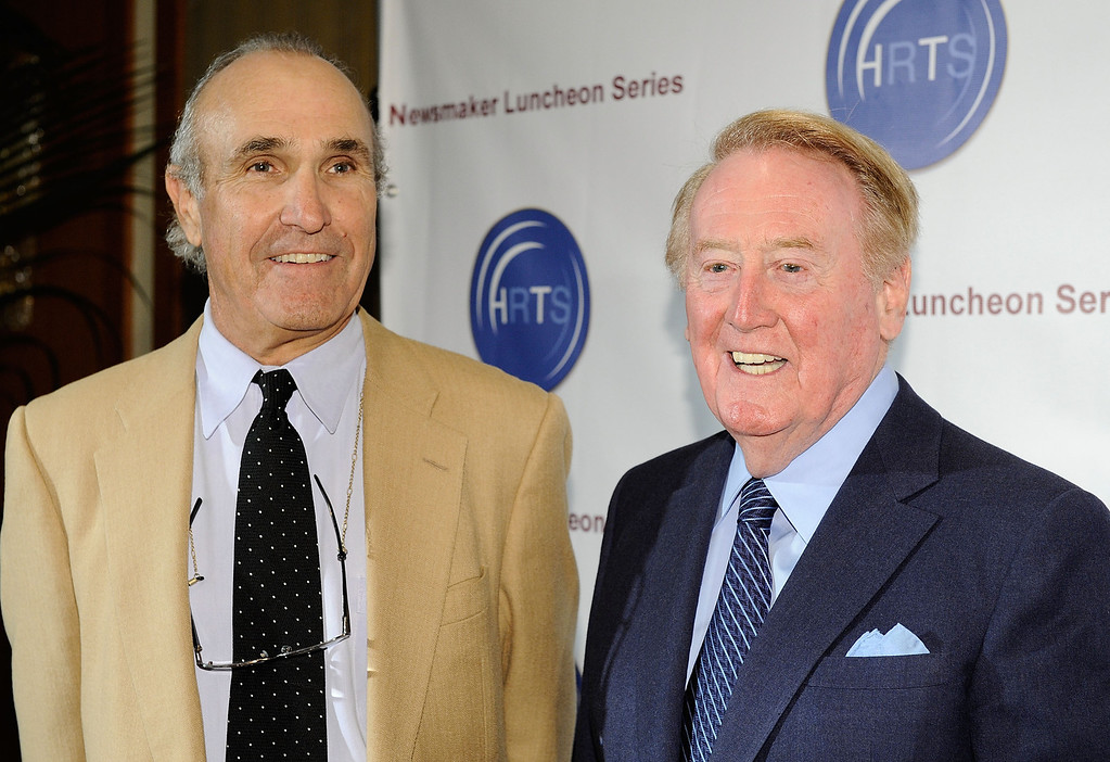 Description of . BEVERLY HILLS, CA - NOVEMBER 10:  Director Ron Shelton (L) and Voice of the Los Angeles Dodgers Vin Scully attend the Hollywood Radio & Television Society Newsmaker Lunheon at the Beverly Wilshire Hotel  on November 10, 2009 in Beverly Hills, California.  (Photo by Michael Buckner/Getty Images)
