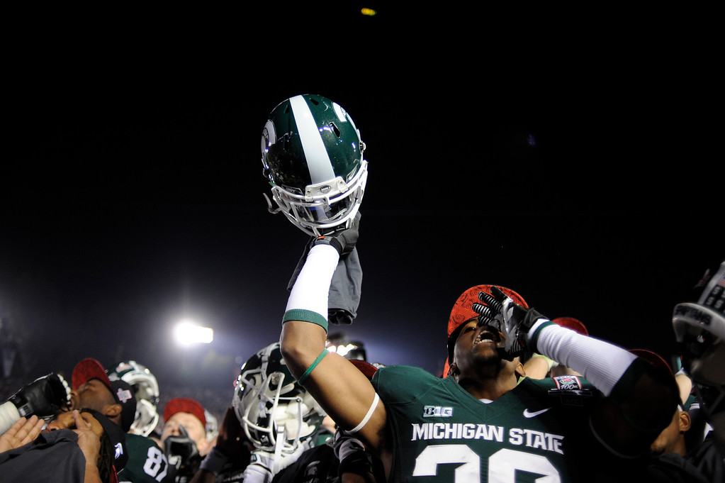 Description of . Michigan State's Jermaine Edmondson cheers after winning  the 100th Rose Bowl game in Pasadena Wednesday, January 1, 2014. Michigan State defeated Stanford 24-20. (Photo by Hans Gutknecht/Los Angeles Daily News)