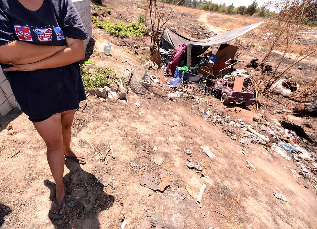 Description of . Dawna Bonner, 30, stands outside the homeless camp she's been living at in San Bernardino August 14, 2013. GABREL LUIS ACOSTA/STAFF PHOTOGRAPHER.