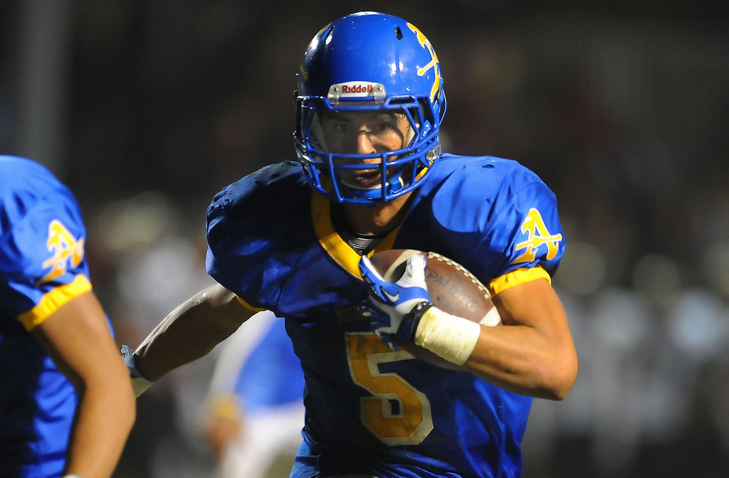 Description of . Bishop Amat's Anthony Camargo (C) runs for a touchdown against Alemany in the first half of a prep football game at Bishop Amat High School in La Puente, Calif., on Friday, Oct. 25, 2013.    (Keith Birmingham Pasadena Star-News)