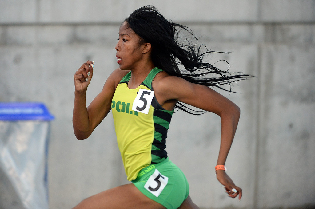 Description of . Long Beach Poly's competes Kymber Payne competes in the 300 meter hurdles during the CIF California State Track & Field Championships at Veteran's Memorial Stadium on the campus of Buchanan High School in Clovis, Calif., on Saturday, June 7, 2014.   (Keith Birmingham/Pasadena Star-News)