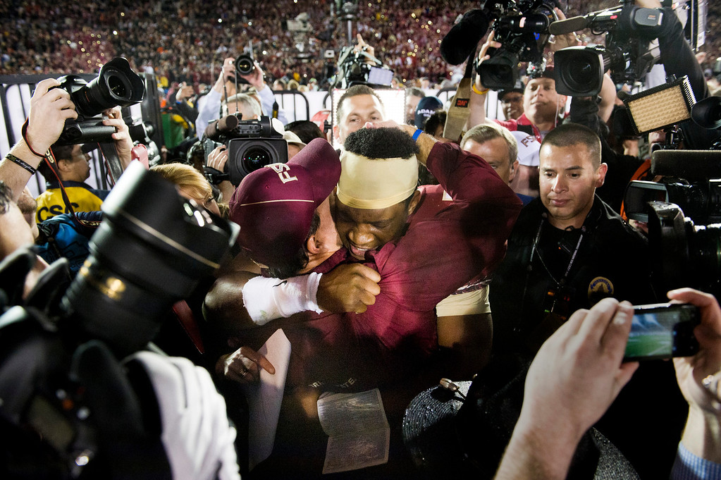 Description of . Florida State head coach Jimbo Fisher celebrates with quarterback Jameis Winston (6) after winning the BCS National Championship game over Auburn at the Rose Bowl in Pasadena Calif. on Monday, Jan. 6, 2014. (Watchara Phomicinda/ Pasadena Star-News)