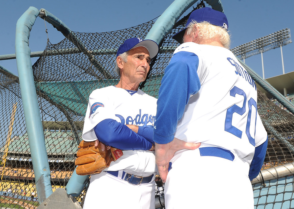 Description of . Hall of famer and former Los Angeles and Brooklyn Dodger left handed pitcher Sandy Koufax, left, talks with hall of famer and former Los Angeles Dodgers right hander, Don Sutton during the Old-Timers game prior to a baseball game between the Atlanta Braves and the Los Angeles Dodgers on Saturday, June 8, 2013 in Los Angeles. 
