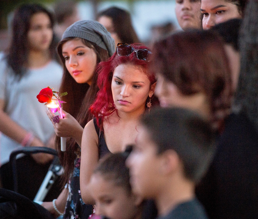 Description of . Relatives, friends and neighbors mourn the death of Irais Acosta, 19, with a memorial at her mother's Garfield Avenue home in Pasadena, Calif. Feb. 17, 2014.  (Staff photo by Leo Jarzomb/Pasadena Star-News)