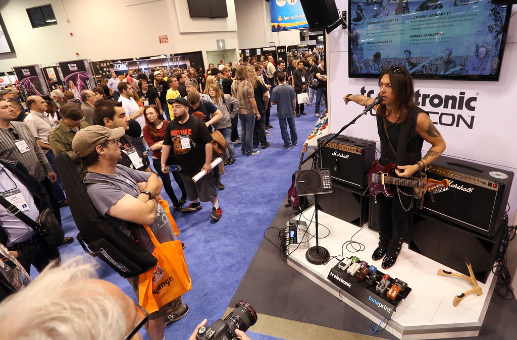 Description of . attends the 2014 National Association of Music Merchants show at the Anaheim Convention Center on January 25, 2014 in Anaheim, California.