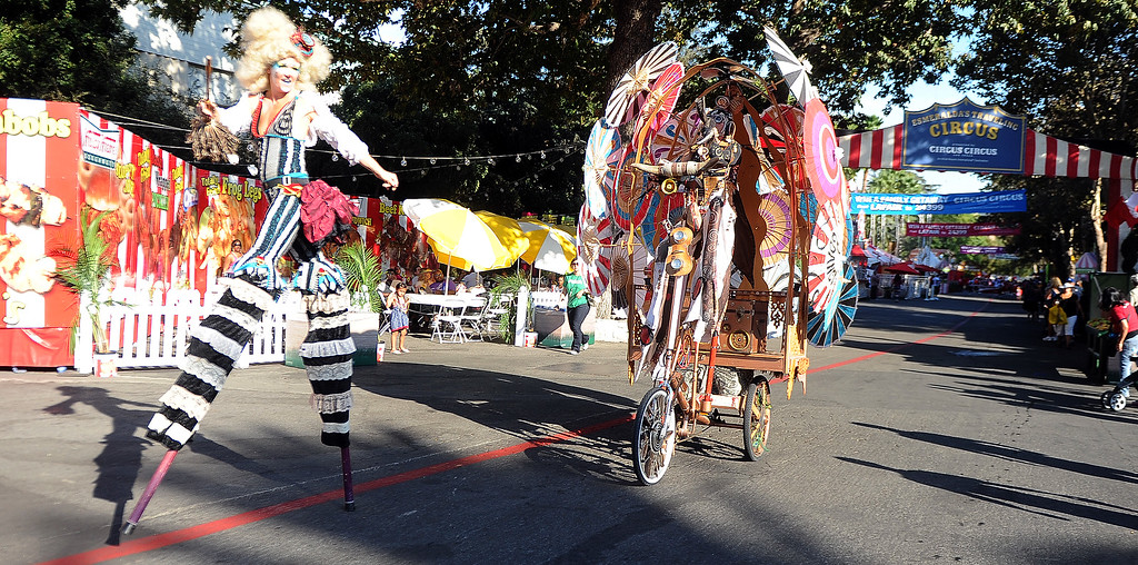 Description of . Circus acts performs during the Diamond Bar community parade during the 91st Annual L.A. County Fair in Pomona, Calif. on Thursday, Sept. 5, 2013.   (Photo by Keith Birmingham/Pasadena Star-News)