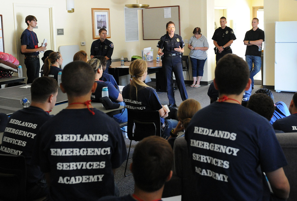 Description of . (John Valenzuela/ Staff Photographer) Redlands Police Corporal Cindy Gourlay talks with Redlands Emergency Services Academy (R.E.S.A) students during orientation at the University Redlands, July 17, 2013. The annual academy, which has twenty participating this year, takes high school grads on a week long course to see if they have what it takes to have a career in public safety. RESA is taught by area firefighters and police officers.